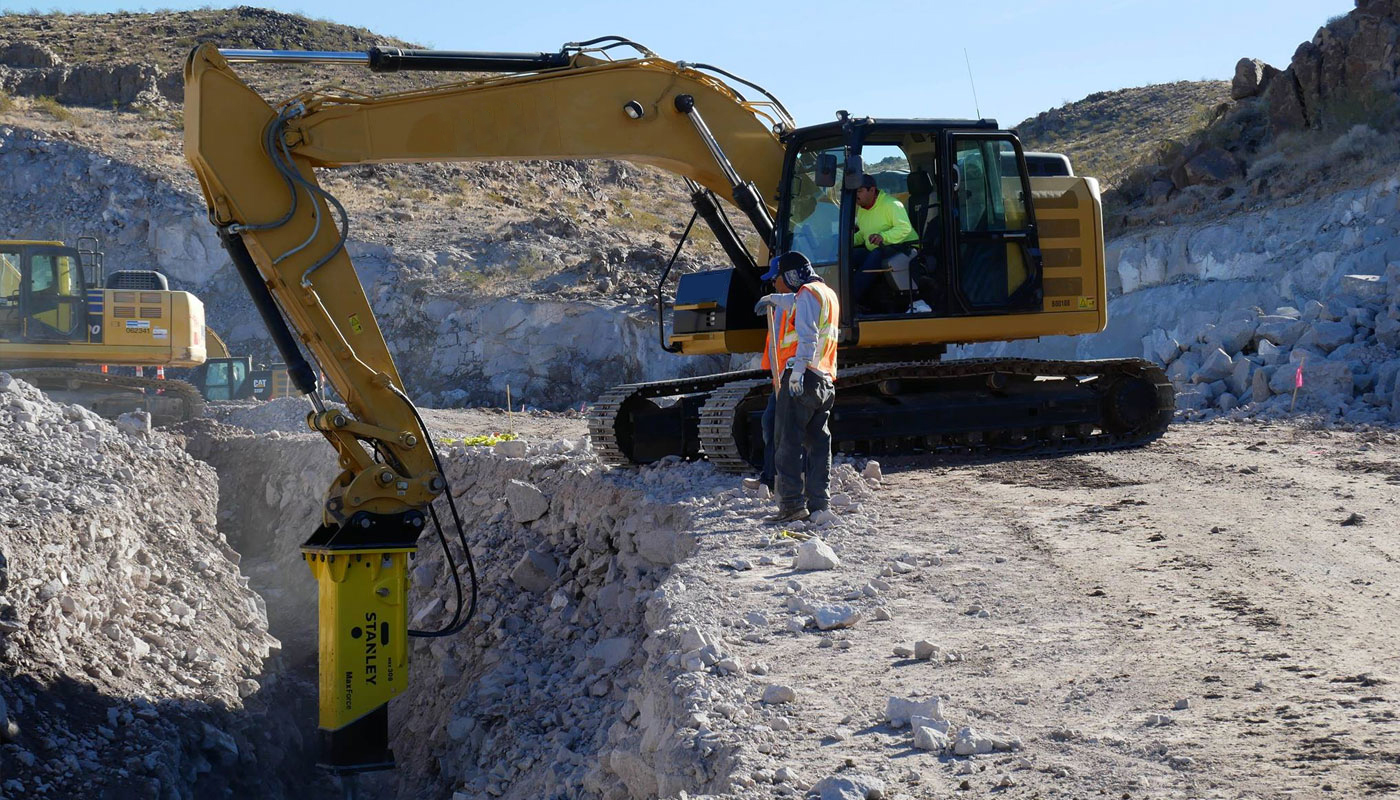 Excavator with Stanley Attachment